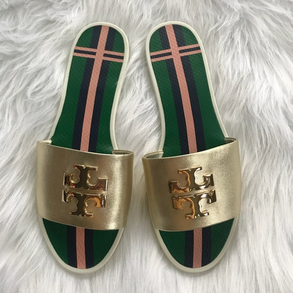 4e7bcc22044 Tory Burch Logo Jelly Slides Gold Size 7. M 5ad0d7bc1dffdab05131219a